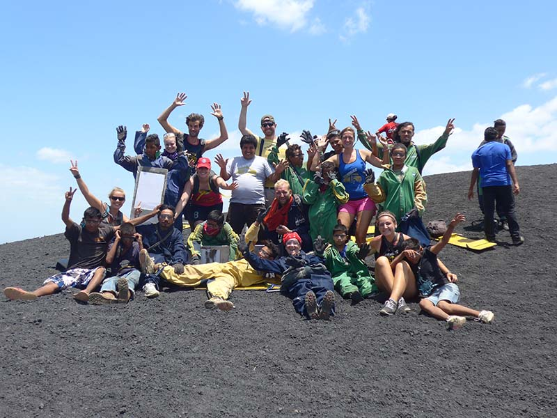 Quetzaltrekkers guides and Chavaladas kids on the top of cerro negro